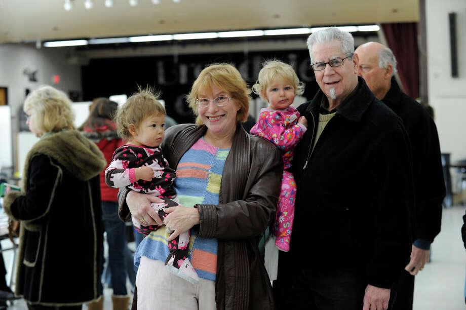 Barbara and Joel Leavitt of Danbury were at the Broadview Middle School polling place in Danbury, Ct. with their twin grandaughters Tuesday morning, Nov. 6, 2012. Photo: Carol Kaliff / The News-Times