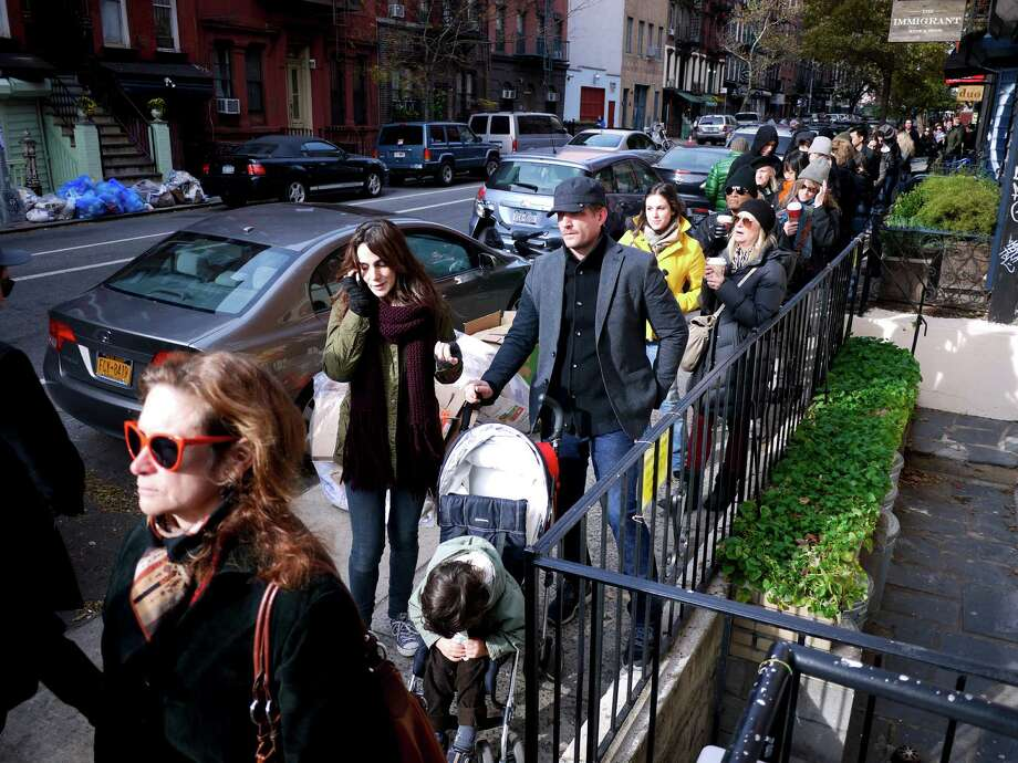 Voters line up to cast their ballots outside a polling station in the East Village neighborhood of New York, on Election Day, Nov. 6, 2012. Hurricane Sandy caused widespread power outages to the area last week. (John Marshall Mantel/The New York Times) Photo: JOHN MARSHALL MANTEL, NYT / NYTNS