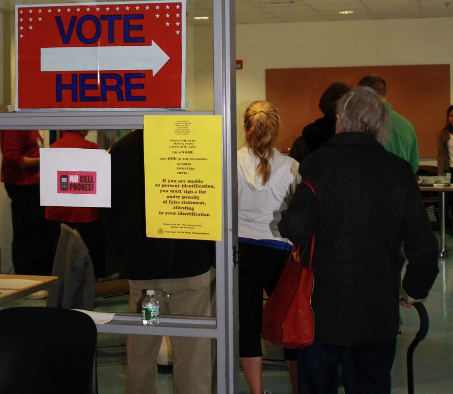 Darien District 5 residents wait in line to cast their vote at Darien High School. Nov. 6, 2012. Photo: Megan Davis