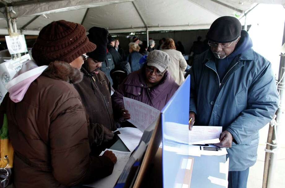 Voters fill out affidavit ballots under a tent at a consolidated polling station for residents of the Rockaways on Election Day, Tuesday, Nov. 6, 2012, in the Queens borough of New York. Photo: Jason DeCrow, AP / FR103966 AP