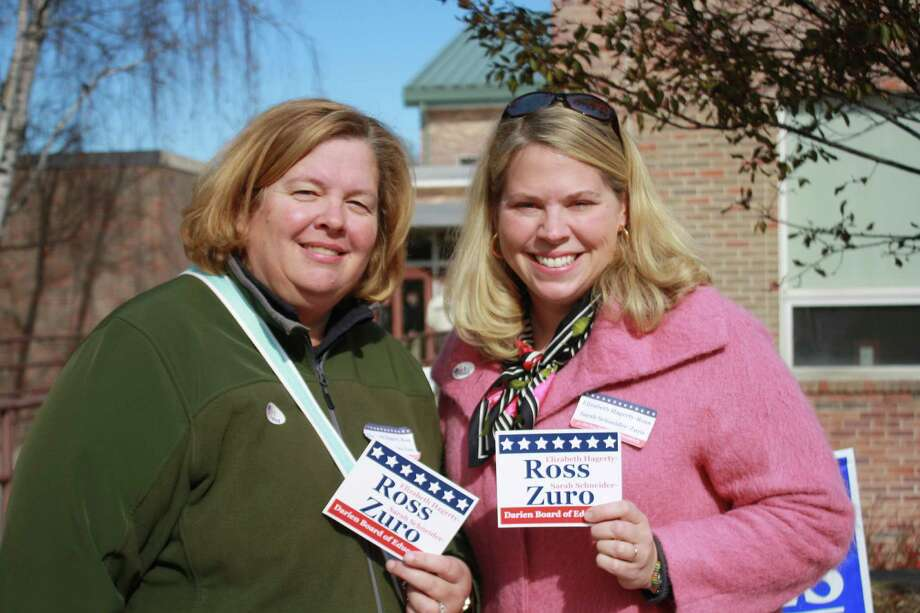 Board of Education Candidates Elizabeth Hagerty-Ross and Sarah Schneider-Zuro outside Town Hall on Election Day. Nov. 6, 2012. Photo: Megan Davis