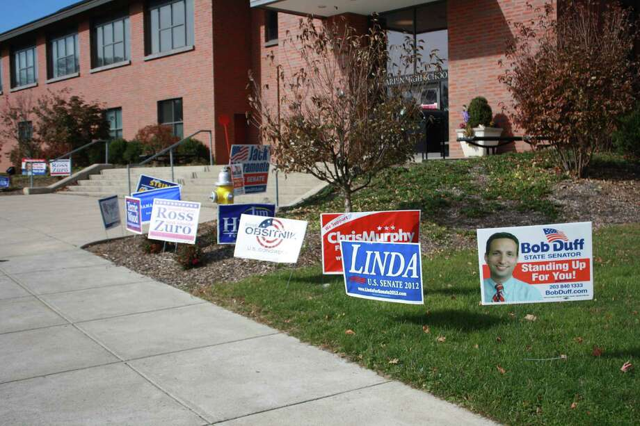 Signs set up at Darien High School for election candidates. Nov. 6, 2012. Photo: Megan Davis