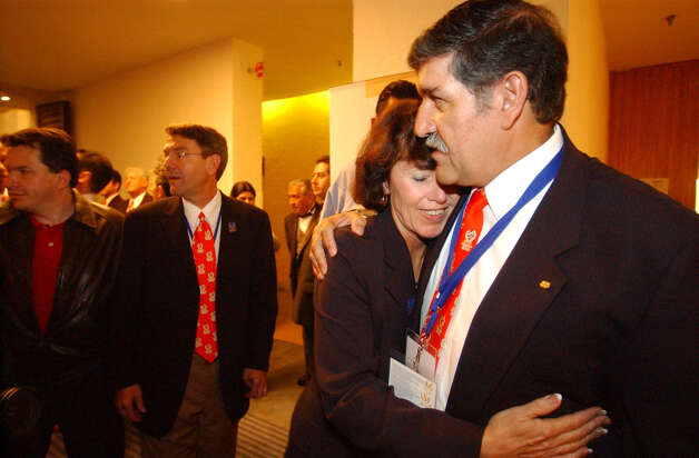 Susan Blackwood hugs Dr. Ricardo Romo after San Antonio lost the bid for the Pan Am 2007 games to Rio de Janeiro at the Camino Real in Mexico City on Saturday, August 24, 2002. ( JERRY LARA STAFF ) Photo: JERRY LARA, SAN ANTONIO EXPRESS-NEWS / SAN ANTONIO EXPRESS-NEWS
