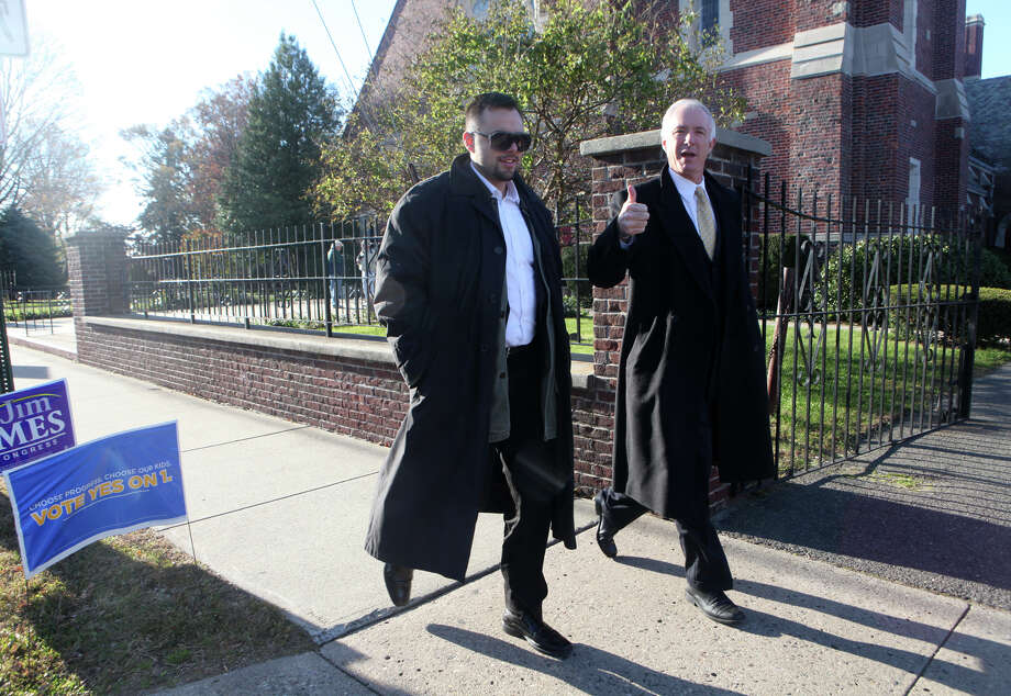 "Mayor Bill Finch, right, votes at the Black Rock School polling location in Bridgeport on Tuesday, November 6, 2012. The Mayor gives a thumbs up referring to signs that call for a ""yes"" vote on a charter-revision referendum that would give the mayor power to appoint the school board. Photo: Unknown, B.K. Angeletti / Connecticut Post freelance B.K. Angeletti"