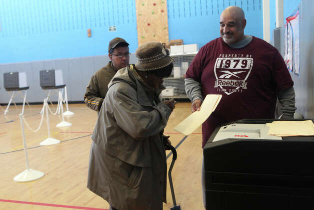 "George Rodriquez, right,  greets voters after handing in their ballot with "" Thank you for Voting. Have a good day "" at Geraldine Johnson School polling location in Bridgeport on Tuesday, November 6, 2012. Photo: Unknown, B.K. Angeletti / Connecticut Post freelance B.K. Angeletti"