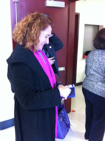 Photo of Elizabeth Esty: Elizabeth Esty casts her vote in Cheshire Tuesday morning after visiting several polling places in the 5th District, including Danbury. Photo: Brian Lockhart