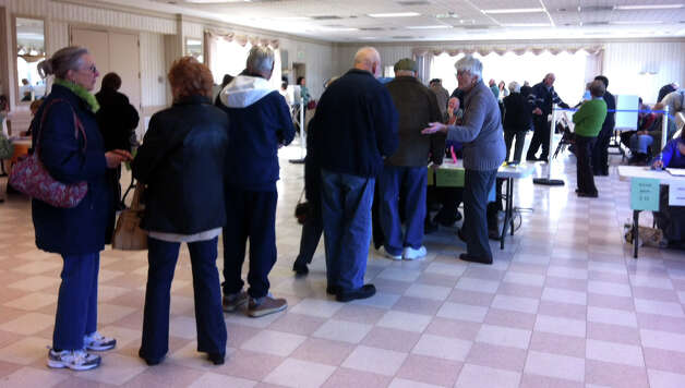 Voters queue up at the Southbury Fire Department Tuesday morning. The early turnout was so strong that the moderator brought in a second tabulating machine to take completed ballots Photo: Jacqueline Smith / The News-Times