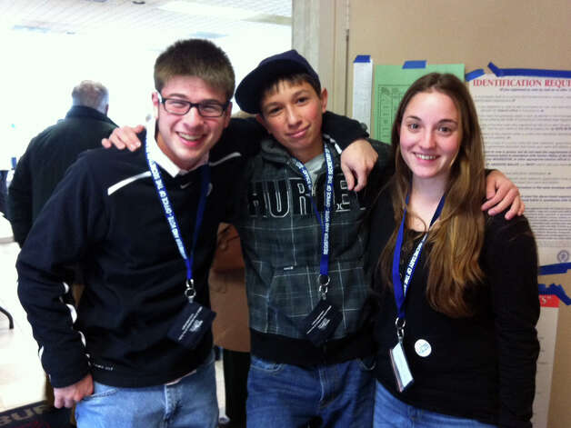 Drew Berkowitz Jr., left, Zach Little and Samantha Mackbach, all students at Pomperaug High School, help direct voters to the right line at Southbury Fire Department Tuesday Photo: Jacqueline Smith / The News-Times