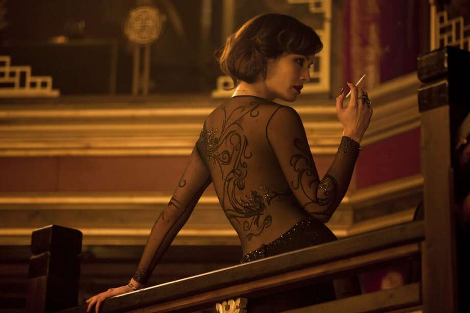 Bernice Marlohe stars in SKYFALL and takes on a dragon-look with OPI nail polish.   ( Francois Duhamel)