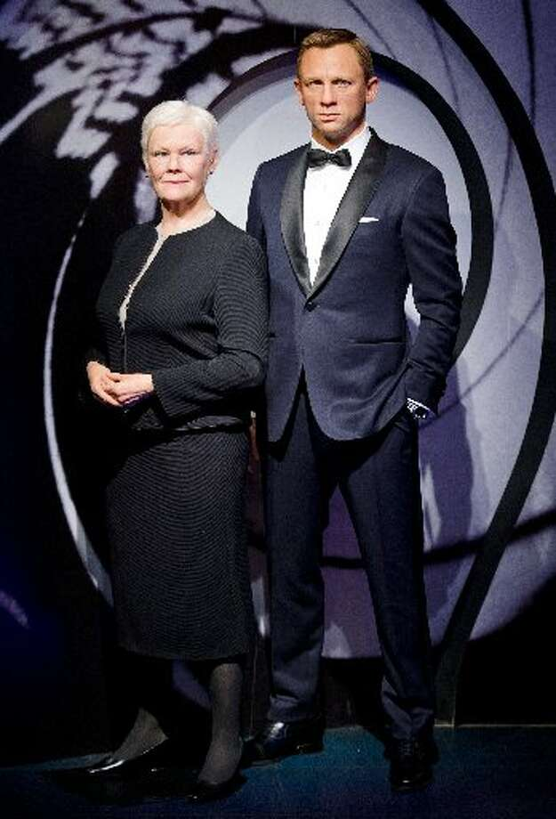 Wax figures of actors Judi Dench and Daniel Craig at Madame Tussauds in London were unveiled in October.