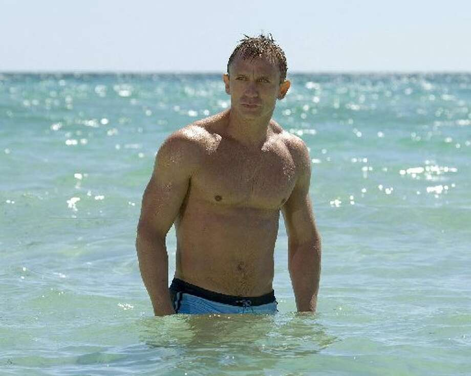 A very fit Daniel Craig as James Bond.
