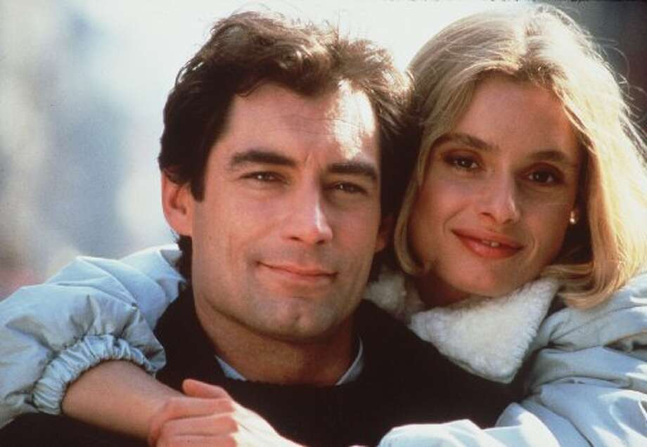 "Timothy Dalton as James Bond with Maryam d'Abo in 1987's ""The Living Daylights."""
