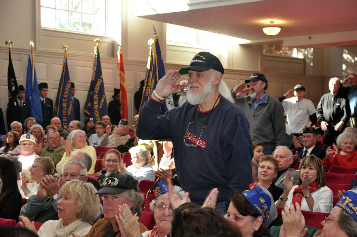 Fred Roos, of Norwalk, salutes during the Service Song Medley during the Veterans Day ceremony at Norwalk City Hall on Thursday, Nov. 11, 2010. Roos served in the Navy during the Korean War.