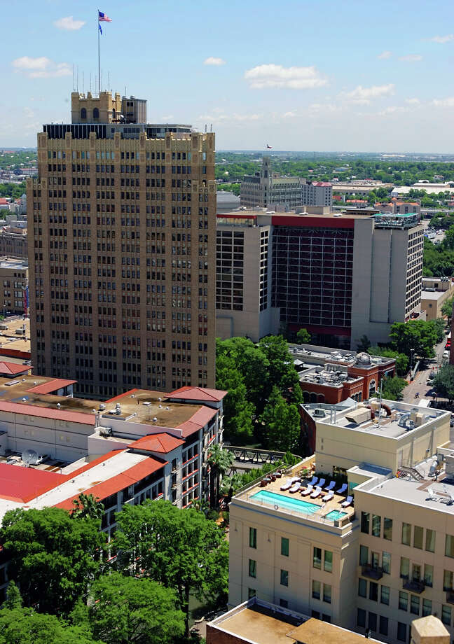 Nix Professional Building (the tall building behind the La Mansion Hotel's red roof) in San Antonio: 323 feet, 23 stories Photo: WILLIAM LUTHER, SAN ANTONIO EXPRESS-NEWS / SAN ANTONIO EXPRESS-NEWS
