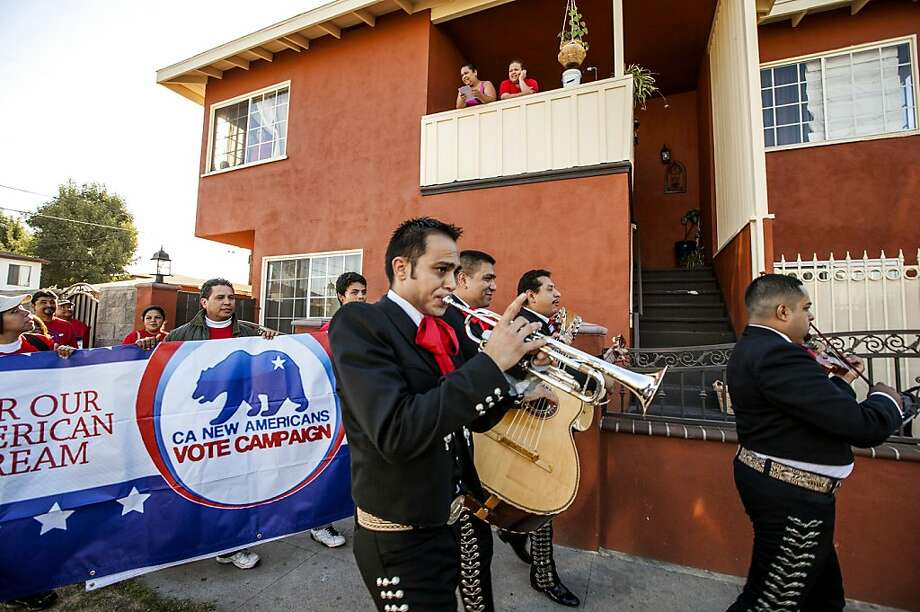 """Members of the mariachi band """"Gallos de Jalisco"""" serenade California citizens to get out and cast their vote on Tuesday, Nov. 6, 2012 in the Sun Valley district of Los Angeles. After a grinding presidential campaign President Barack Obama and Republican presidential candidate, former Massachusetts Gov. Mitt Romney, yield center stage to American voters Tuesday for an Election Day choice that will frame the contours of government and the nation for years to come. Photo: Damian Dovarganes, Associated Press"""