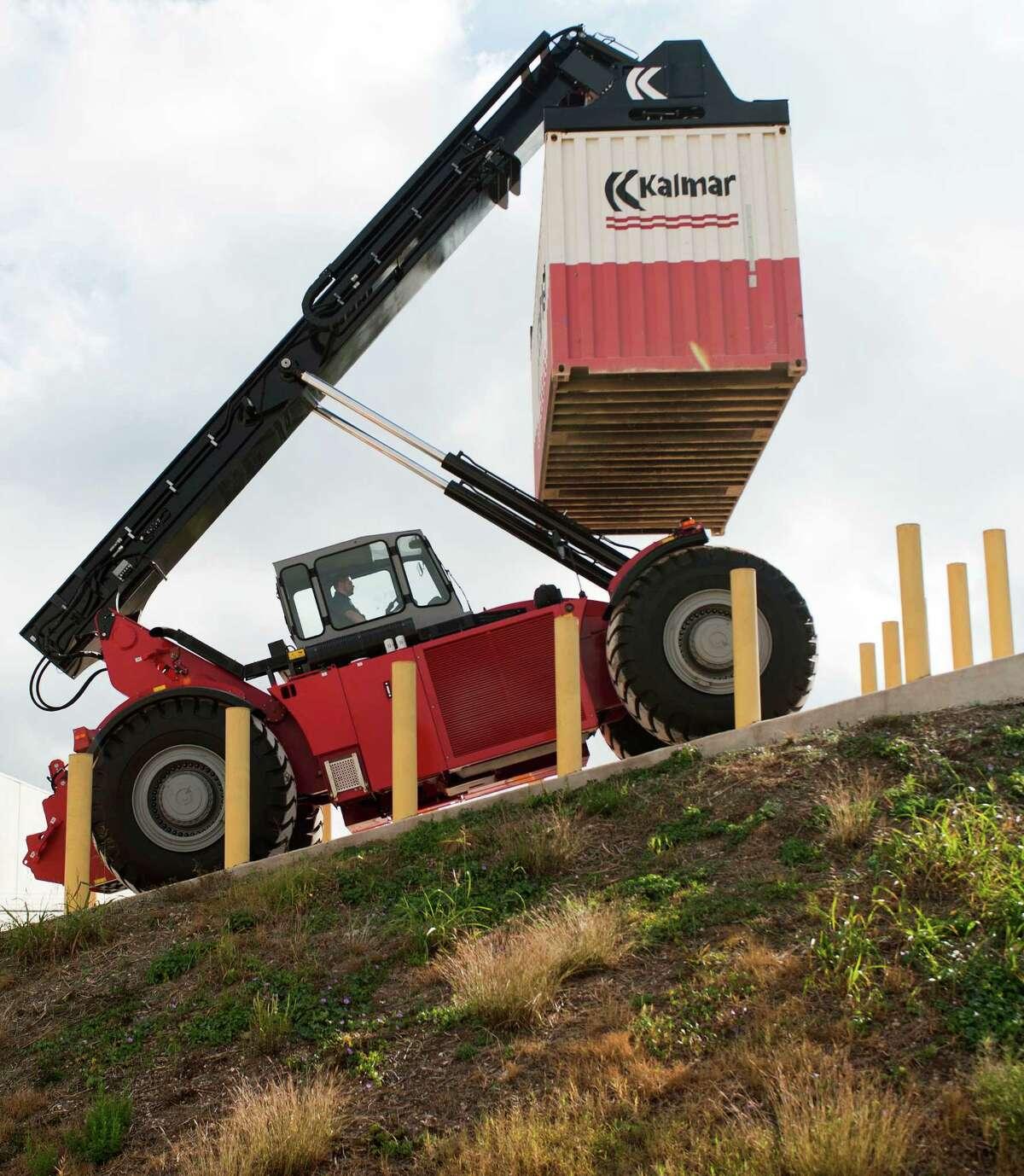 A Kalmar RT240 rough terrain reach stacker is demonstrated, Friday, Nov. 2, 2012, at the Kalmar RT Center production facility in Cibolo, Texas.