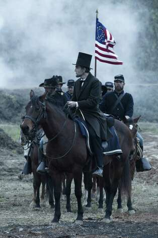 "President Abraham Lincoln (Daniel Day-Lewis) looks across a battlefield in the aftermath of a terrible siege in this scene from director Steven Spielberg's drama ""Lincoln."" Photo: David James, SMPSP, DreamWorks / ©DreamWorks II Distribution Co., LLC.  All Rights Reserved."