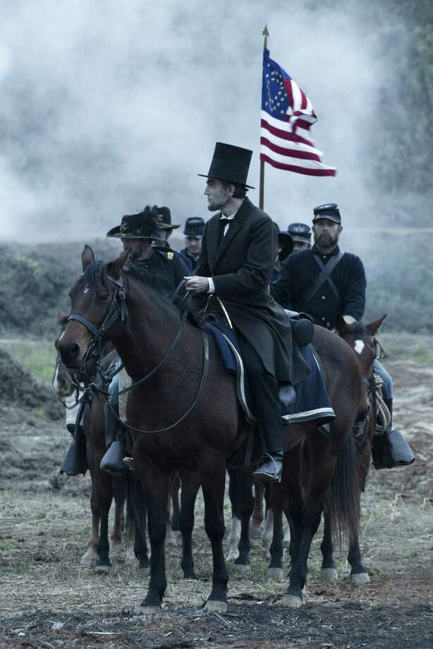 """President Abraham Lincoln (Daniel Day-Lewis) looks across a battlefield in the aftermath of a terrible siege in this scene from director Steven Spielberg's drama """"Lincoln."""" Photo: David James, SMPSP, DreamWorks / ©DreamWorks II Distribution Co., LLC. All Rights Reserved."""
