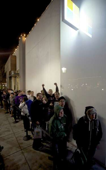 Fans wait in line to buy Halo 4 during the game's launch, on Tuesday, Nov. 6, 2012 in Seattle.