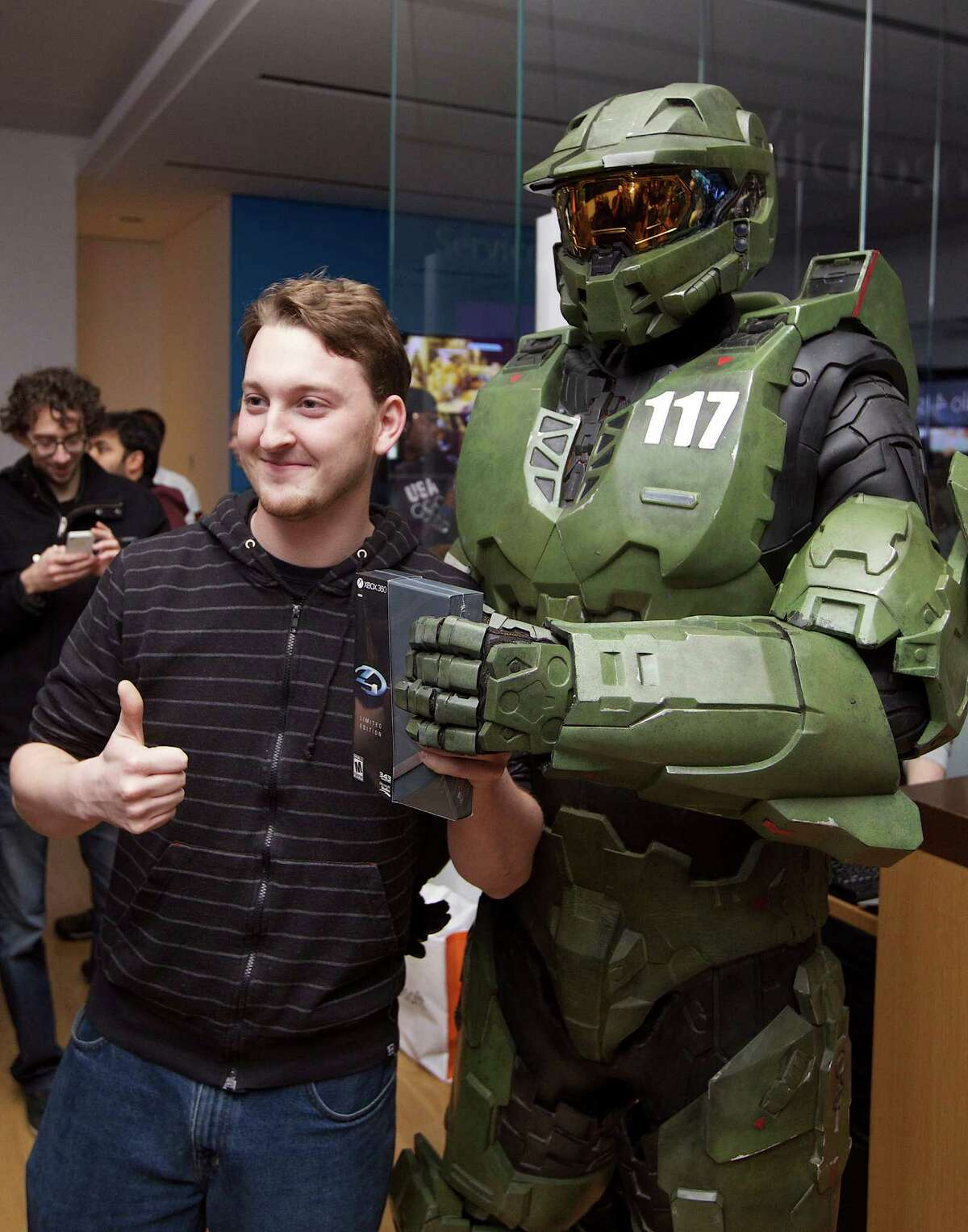 Fans lined up Monday night in Seattle to get their hands on Halo 4, the latest entry in the Xbox game franchise. Peter Gagnon of Seattle was first in line, getting the game just after midnight and a chance to pose with Halo character Master Chief.