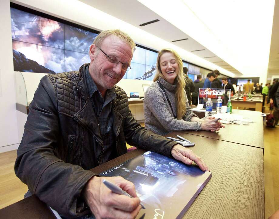 Halo voice actors Steve Downes, left, and Jen Taylor  sign autographs for fans at the Halo 4 Launch, on Monday, Nov. 5, 2012 in Seattle. Photo: Invision For Xbox