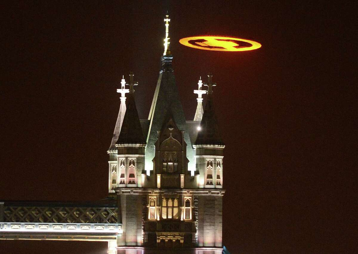 The Halo glyph is seen over Tower Bridge in London on Nov. 5, 2012, for the launch of Halo 4.
