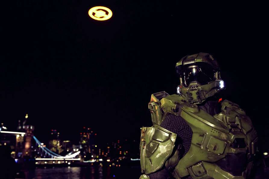 Master Chief poses in front of the Halo glyph, seen over Tower Bridge in London on Nov. 5, 2012, for
