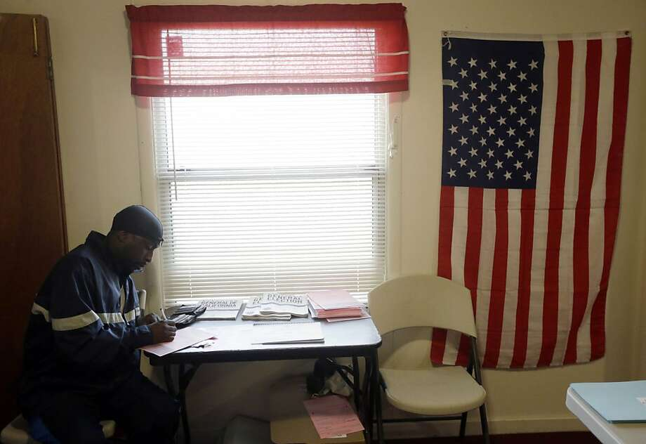 Deric Perry votes at a church in Stockton, Calif. on Tuesday, Nov.  6, 2012. Photo: Marcio Jose Sanchez, Associated Press
