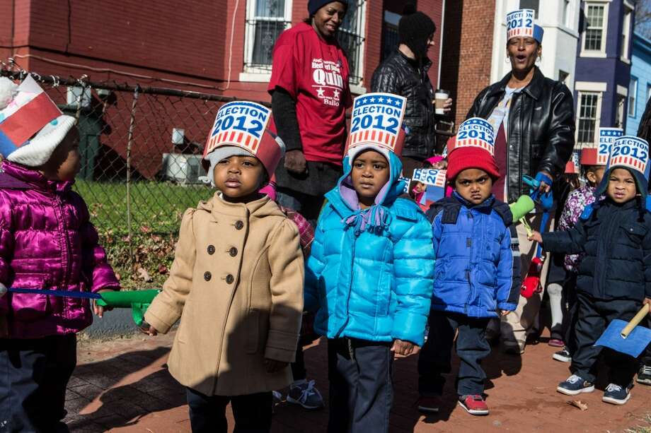 WASHINGTON, D.C. - NOVEMBER 6: Children from Kingdom Kinds Child Development Center march past a polling station to get out the vote at Dunbar High School on November 6, 2012 in Washington, DC. The latest polls continue to show a tight race between President Barack Obama and Republican challenger Mitt Romney. (Photo by Brendan Hoffman/Getty Images) (Getty Images)