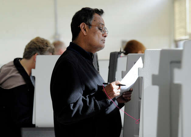 Voters cast their ballots on Election Day, Tuesday, Nov. 6, 2012, at the Broadview Middle School polling place in Danbury Tuesday morning. Photo: Carol Kaliff / The News-Times