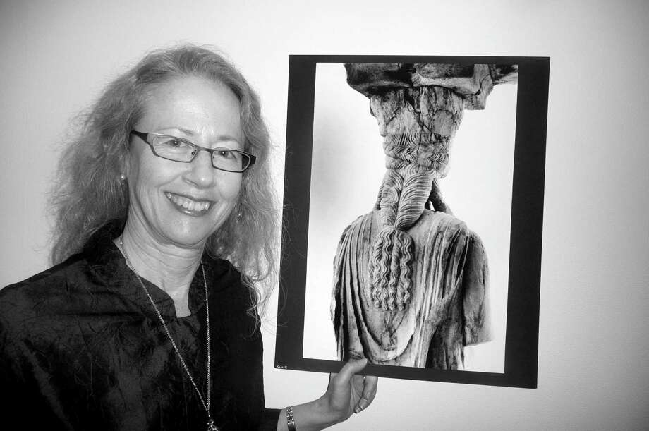 "Fairfield University Professor Katherine ""Kathy"" Schwab has made a study of the classical Greek hairstyles of the famous Caryatids (maidens) of the Athenian Acropolis. Photo: Contributed Photo"