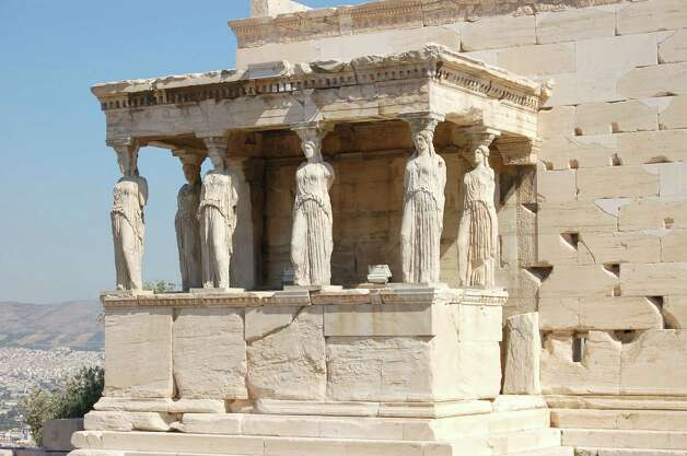 The Caryatids, six maidens made of stone, have stood for more than 2,000 years holding up the South Porch of the Erechtheion on the Athenian Acropolis. They each exhibit an elaborate hairstyle. Photo: Contributed Photo