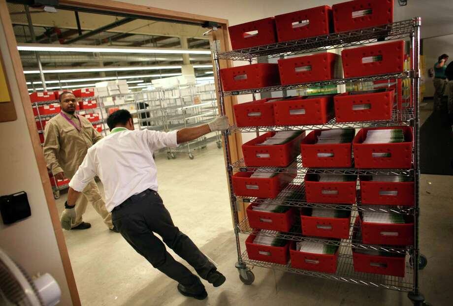 Ballots are wheeled around in the King County ballot-processing facility in Renton on Election Day, Tuesday, November 6, 2012. Photo: JOSHUA TRUJILLO / ASSOCIATED PRESS