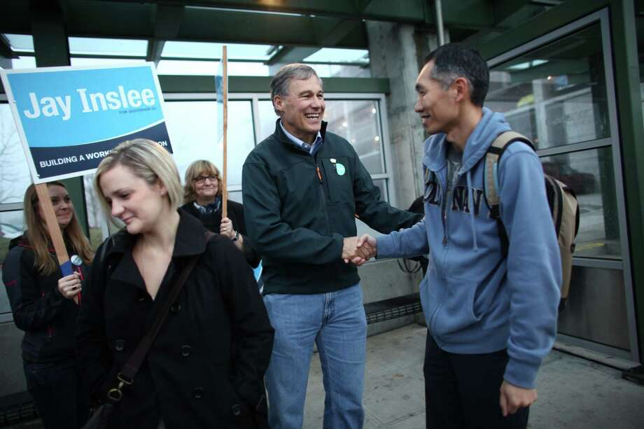 Democratic candidate for governor Jay Inslee shakes hands at the Eastgate Park-and-Ride in Bellevue on Election Day. Photo: JOSHUA TRUJILLO / ASSOCIATED PRESS