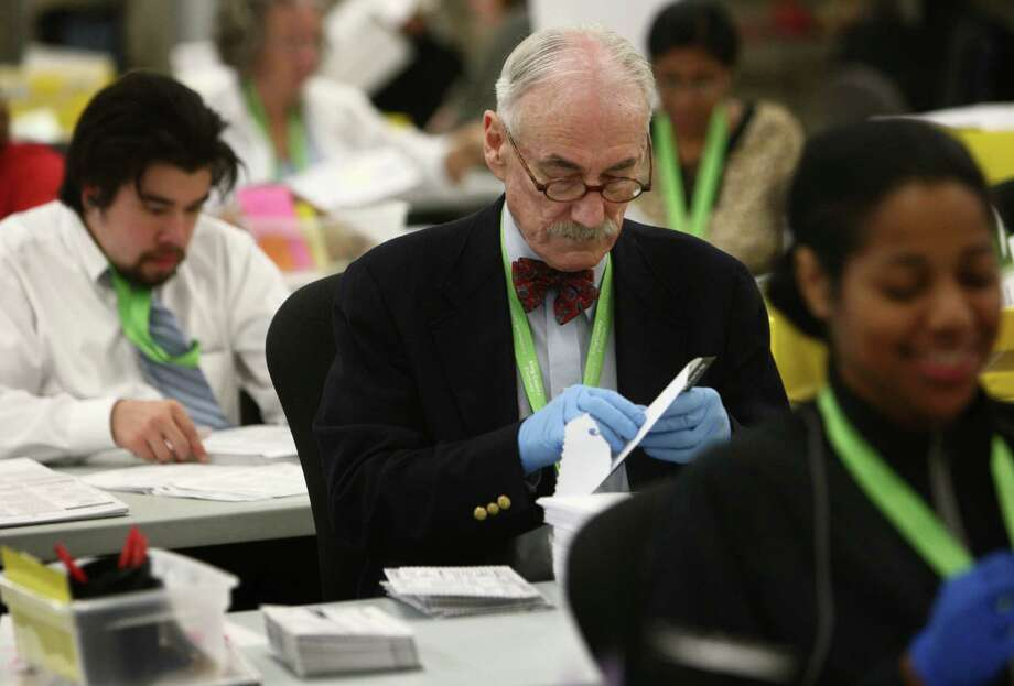 Tom Henning opens ballots at the King County ballot-processing facility in Renton on Election Day. Photo: JOSHUA TRUJILLO / ASSOCIATED PRESS