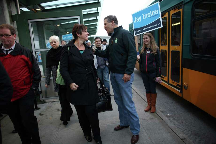 Democratic candidate for Washington State Governor, Jay Inslee, shakes hands at the Eastgate Park-and-Ride in Bellevue on Election Day, Tuesday, November 6, 2012. Photo: JOSHUA TRUJILLO / ASSOCIATED PRESS