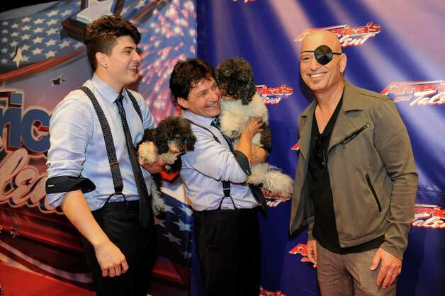 """America's Got Talent"" judge Howie Mandel, right, clowns around with last season's winners Olate Dogs. Photo: NBC"