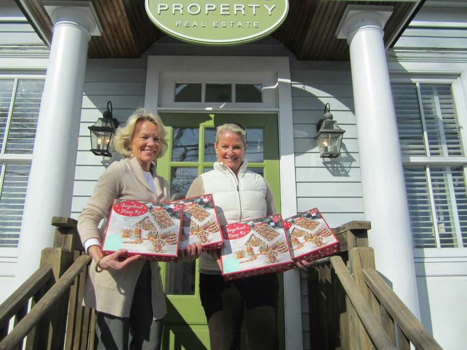 Susan Valk of Halstead Property and Tucker Murphy of the New Canaan Chamber of Commerce announce that free gingerbread house kits are available to children in preparation for the annual Holiday Stroll. Photo: Contributed