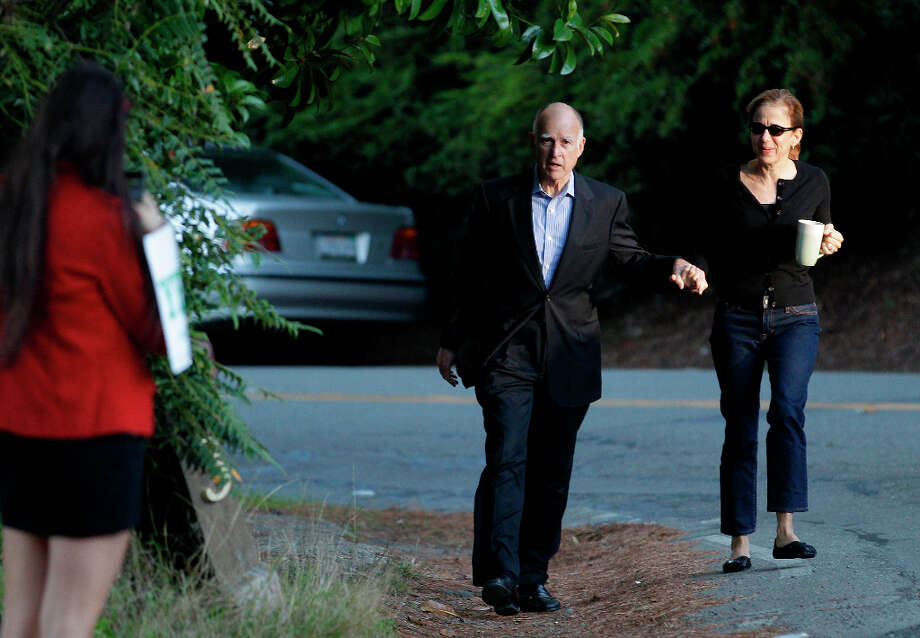California Gov. Jerry Brown walks with his wife Anne Gust Brown to vote Tuesday, Nov. 6, 2012 at a fire station in Oakland, Calif. (AP Photo/Eric Risberg) Photo: Eric Risberg, Associated Press / AP