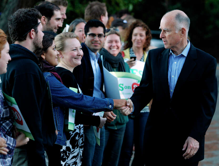 Gov. Jerry Brown meets with supporters of his Prop. 30 school tax initiative before he votes in Oakland, Calif. on Tuesday, Nov. 6, 2012. Photo: Paul Chinn, The Chronicle / ONLINE_YES