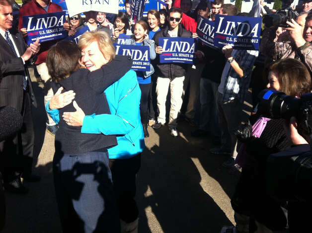 U.S. Senate candidate Linda McMahon hugs state Rep. Livvy Floren, R-149th District, a fellow Greenwich Republican, on her way in to vote at North Street School Tuesday, Nov. 6, 2012.