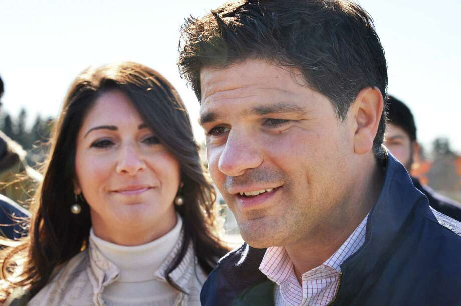 NYS Senate candidate George Amedore and wife Joelle, left, speak with reporters after voting at Schalmont High School in Rotterdam Tuesday Nov. 6, 2012.   (John Carl D'Annibale / Times Union) Photo: John Carl D'Annibale, Albany Times Union / 00019944A