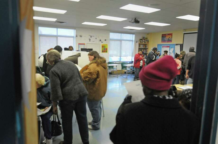 Some voters wait in line to receive their ballot as other voters fill out their ballots at the polling station inside Green Tech High Charter School on Tuesday, Nov. 6, 2012 in Albany, NY.    (Paul Buckowski / Times Union) Photo: Paul Buckowski, Albany Times Union / 00019998A
