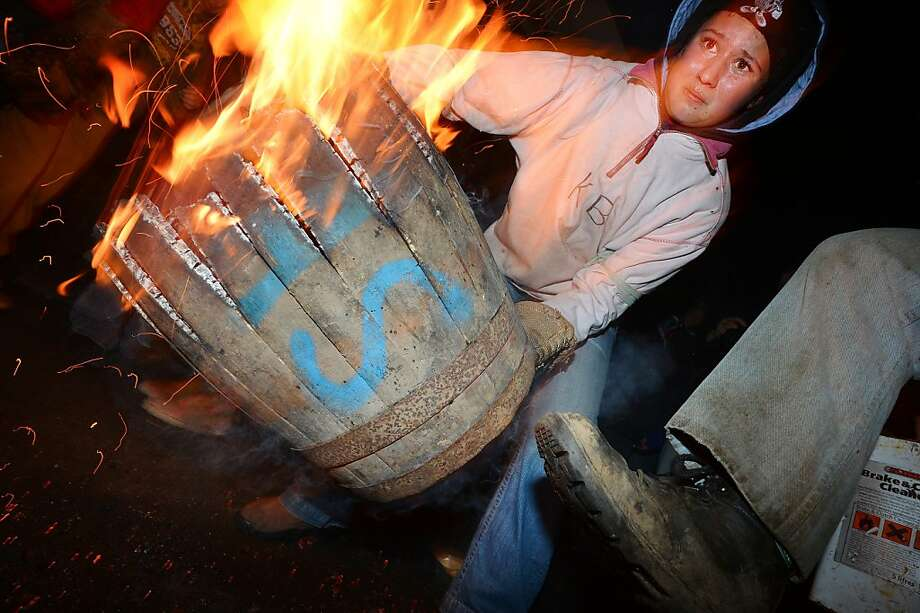 Blazing barrels:A contestant carries a wooden barrel soaked in tar and set on fire during a Guy Fawkes Day race at Ottery St. Mary in Devon, England. Competitors, who may only enter if they were born in Ottery St. Mary, run for as long as they can with the burning barrels. Photo: Ben Stansall, AFP/Getty Images