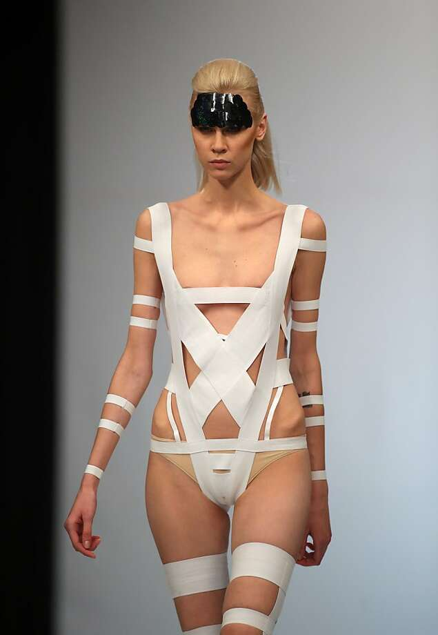 From the Mummy collection:An Olga Kucherenko swimsuit for Belarus Fashion Week appears to be mostly adhesive bandages. Photo: Sergei Grits, Associated Press