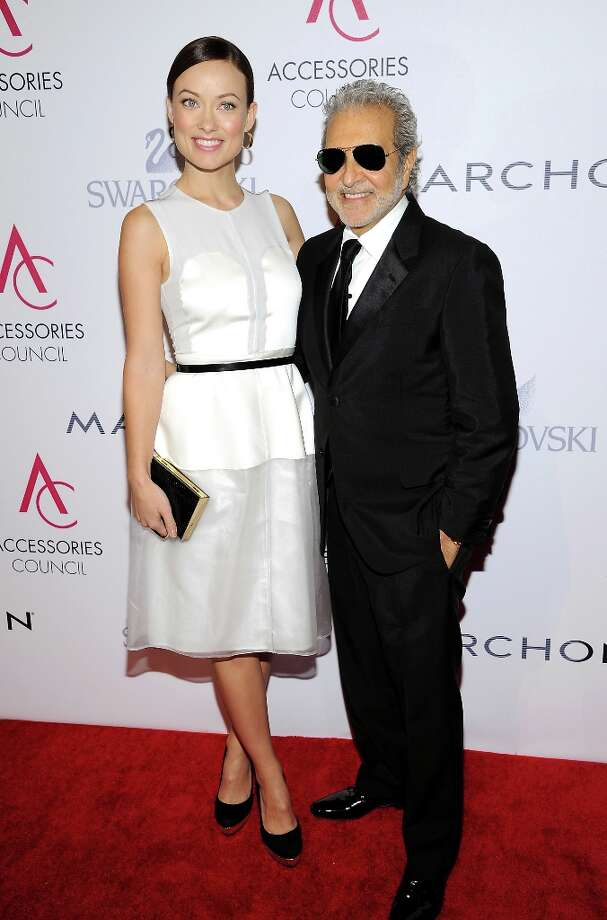 Actress Olivia Wilde and shoe designer Vince Camuto attend the 16th annual ACE awards hosted by the Accessories Council at Cipriani 42nd Street on Monday, Nov. 5, 2012 in New York. Photo: Evan Agostini, Associated Press / Invision