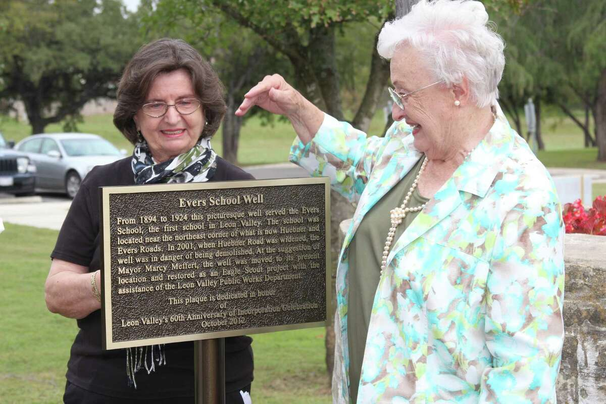 Leon Valley historian Carol Poss (right) reads a newly installed plaque at the Evers School well on the Leon Valley Community and Conference Centers campus with former Mayor Marcy Meffert, who instigated the recovery of the well from its original site at Huebner and Evers roads.