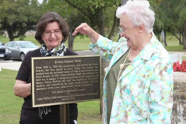 Leon Valley historian Carol Poss (right) reads a newly installed plaque at the Evers School well on the Leon Valley Community and Conference Centers campus with former Mayor Marcy Meffert, who instigated the recovery of the well from its original site at Huebner and Evers roads. Photo: Lauri Gray Eaton / Northwest Wee