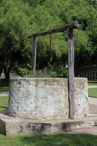 A well that was at the now-defunct Evers School was moved to the campus of the Leon Valley Community and Conference Centers and now has received a plaque to alert visitors to its significance. Photo: Lauri Gray Eaton / Northwest Wee