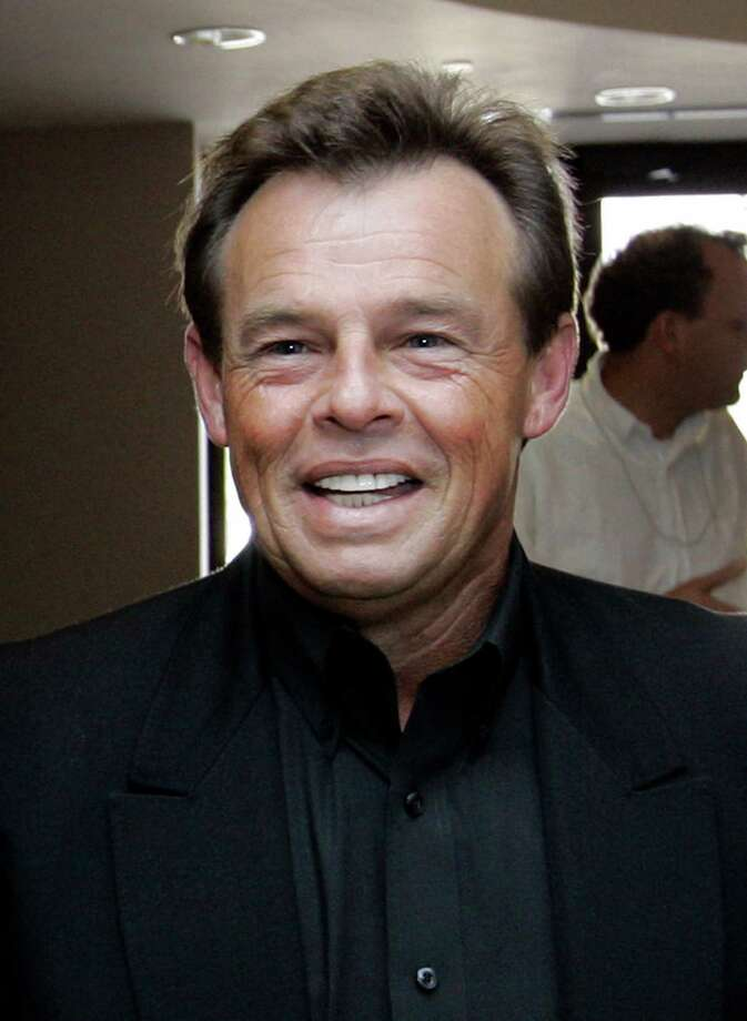 "FILE - This Sept. 5, 2007 file photo shows country singer Sammy Kershaw at the Secretary of State's office in Baton Rouge, La. Kershaw's tour bus was struck by another vehicle on Friday, Nov. 2, 2012 in Nocona, Texas. The impact caused major damage to the bus, and the car was totaled. The driver of the car was hospitalized with injuries. Kershaw and the nine members of his band and crew were shaken and sore but not seriously hurt. Kershaw scored major hits in the early 90s, including ""She Don't Know She's Beautiful"" and ""I Can't Reach Her Anymore."" He has sold over five million albums. (AP Photo/Alex Brandon, file) Photo: Alex Brandon"